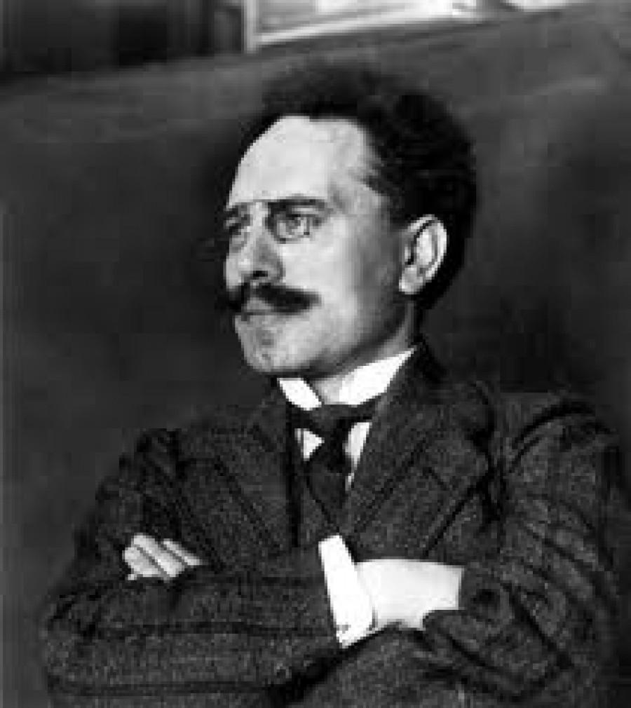 """Karl Liebknecht (13. srpna 1871 v Lipsku – 15. ledna 1919 v Berlíně), byl německý socialistický politik a spoluzakladatel Komunistické strany Německa (KPD), který jako jeden ze dvou ze sociálně demokratických poslanců na počátku války v roce 1914 hlasoval proti """"válečným úvěrům"""", protože byl ale slavnější, na druhého sociálního demokrata se """"zapomnělo"""" a na počest Karla Liebknechta se užívá úsloví: """"1 proti 110"""" (SPD měla v Reichstagu 111 poslanců). Dne 15. ledna byl bez soudu a jakéhokoliv obvinění zavražděn """"Erthardovou Brigádou Smrti"""", vyslanou sociálně demokratickou vládou a hlavně jejím ministrem vnitra Gustavem Noskem, který za potlačení """"Spartakovců"""", Rosy Luxemburgové a Karla Liebknechta, pobíral za Hitlerovy diktatury státní penzi."""